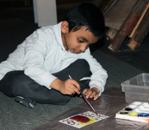 IMG_4395 2013 March Montessori WC boy outside wigwam cropped WR