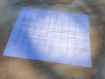 I started by drawing the basic canoe shape out on a grid with the 'water line' marked on.