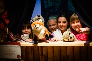 Great shot of kids in puppet theatre
