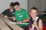 IMG_6856 2013 Paddling Camp week 1 boys paddle carving names wipedWEB-READY