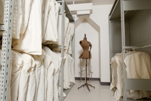 Hanging your garments in unbleached cotton garment bags like these at the Guelph Civic Museum allows your textiles to breath and keeps them dust free.