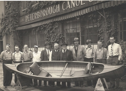 Peterborough Canoe Company staff pose with HRH Elizabeth II wedding canoe