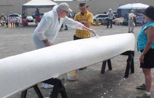 mike elliott filling canvas canoe