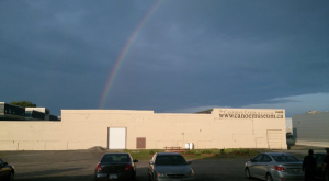 View of the Museum's storage facilities.  Look at the rainbow! I wonder if there is a bucket of gold hidden behind an old dugout?